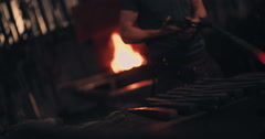 Blacksmith handling glowing iron in workshop - stock footage