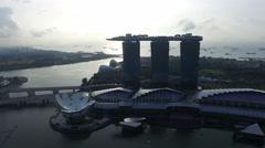 4k aerial footage of Singapore Marina Bay and city skyline during sunrise. Stock Footage