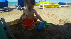 Cute Little Boy Playing with Sand on the Beach Stock Footage