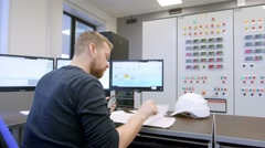 Control room, laborer the operator of the dashboard control production in the - stock footage