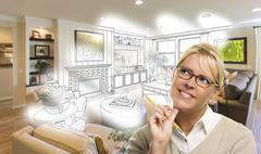 Woman With Pencil Over Living Room Design Drawing and Photo Combination. Stock Photos