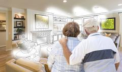 Senior Couple Looking Over Custom Living Room Design Drawing Photo Combinatio Stock Photos