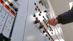 Engineer presses the button on modern control panel Stock Footage