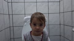 Child does his business at toilet Stock Footage