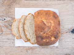 A half of home made village potato bread - stock photo