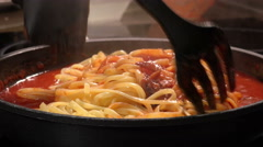 Mixing pasta and sauce in a pan: italian cooking, pasta cooking Stock Footage