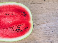 A half of ripe water-melon Stock Photos