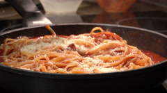 Cooking italian pasta with tomato and Parmesan cheese Stock Footage