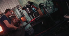 Mechanical press on a blacksmith's workshop in Slow Motion Stock Footage