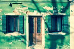 Detail of a traditional green house in Burano island, Venice (vintage effect) - stock photo