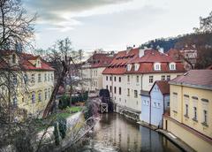 The old medieval mill-wheel on Chertovka channel in Mala Strana - stock photo