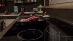 Putting red meat over the grill at home: cooking a steak Stock Footage