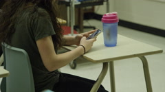 Female student in high school with smart phone sending messages Stock Footage