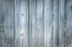 Old rough discolored wood texture - stock photo