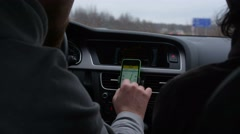 Driver use phone while driving to check the way on GPS Stock Footage