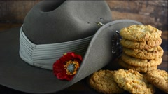 Anzac Day Australian army slouch hat with traditional Anzac biscuits close up Stock Footage