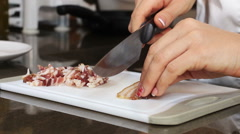 Cutting slices of bacon to cook sauce for pasta: italian cooking Stock Footage