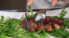 Serve steak slices: sliced beef with arugula, rocket and cherry tomatoes Stock Footage