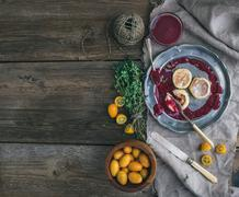 Rustic breakfast set. Russian cheese cakes on a vintage metal plate with ling Stock Photos
