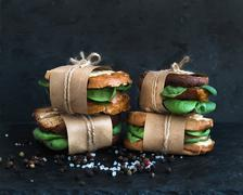 Cured chicken and spinach whole grain sandwiches placed one on a Stock Photos