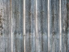 Old rough discolored wooden texture - stock photo