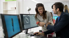 4K Creative technology designers working on computer, designing smart watch - stock footage