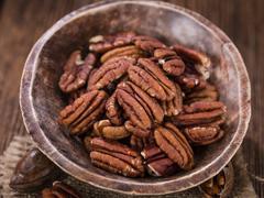 Pecan Nuts (selective focus) - stock photo