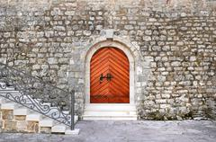 Ancient entrance to the historical building of the citadel in th - stock photo