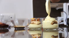 Cooking a tiramisù: italian creamy dessert with cream, coffee, chocolate Stock Footage