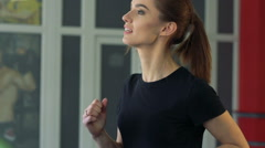 Beautiful girl on a treadmill - stock footage
