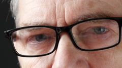 4K Close Up Of Old Man With Glasses Blinking Eyes Stock Footage