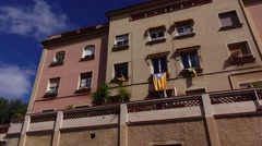 Modern Barcelona house facade, low angle panning shot. Estelada flag hang down Stock Footage