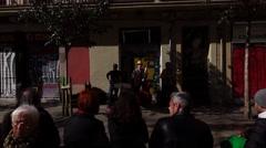 Street musician jazz trio play music and sing at Spanish square, POV camera Stock Footage
