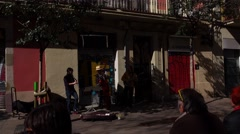 Spaniard street musicians at small square, POV camera move beside. Stock Footage
