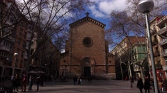 Move closer to old Gothic church, dolly shot across small Barcelona square Stock Footage