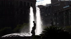 Fountain at Catalonia Square, high contrast, lit by sun, sculpture silhouette Stock Footage