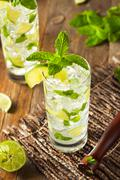 Homemade Alcoholic Mojito with LIme - stock photo