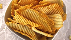 Stock Video Footage of Potato Chips (rippled, seamless loopable 4K footage)