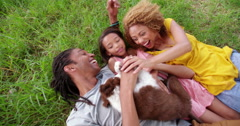 Top view shot of African-American family lying on their backs - stock footage