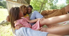 Young family enjoying a relaxing sunny weekend together Stock Footage