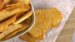 Portion of rippled Potato Chips (seamless loopable 4K footage) Stock Footage