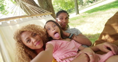 Lovely African-American family making silly faces and posing - stock footage