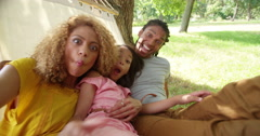 Lovely African-American family making silly faces and posing Stock Footage