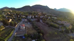 Aerial village landscape, mountains and the sea on distance Stock Footage