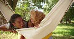 Photogenic Multi-ethnic family relaxing together on a hammock - stock footage