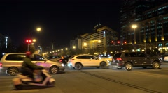 Road traffic at the intersection of Jianguomen & Beijing Station street at night Stock Footage