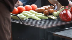 Sausage and vegetables tomatoes peppers aubergines fried on the grill Stock Footage