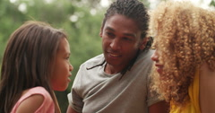 Young African-American family laughing and smiling with their cute daughter Stock Footage