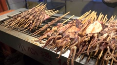 Fried scorpion and other exotic food on a stick at the Wangfujing snack street. Stock Footage