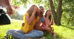 Adorable african-american family blows soap bubbles at eachother - stock footage